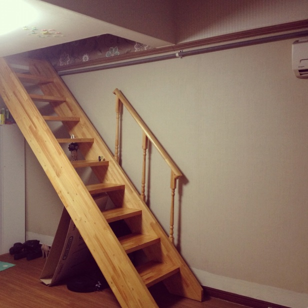 Stairs leading up to bedroom loft.