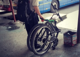 A foldable bike for the bus. Genius!