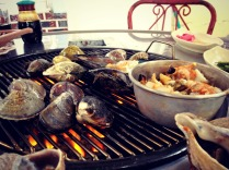 Grilling shellfish and Clint's spicy seafood concoction.