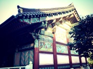 Side view of temple where people were praying. — at 봉은사