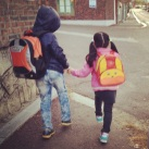 A brother walks his sister to school. The whole time, they're kicking and trying to trip each other. Oh, sibling love.