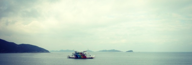 Colorful boat on the waters off the Saemangeum Seawall.