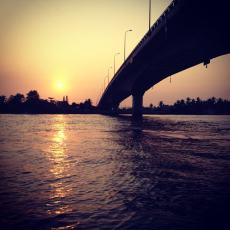 Sun rising over the bridge in Can Tho