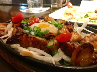 "Filipino ""Bacon & Eggs"" – Crispy Pork, Poached Egg, Tomato, Onion"