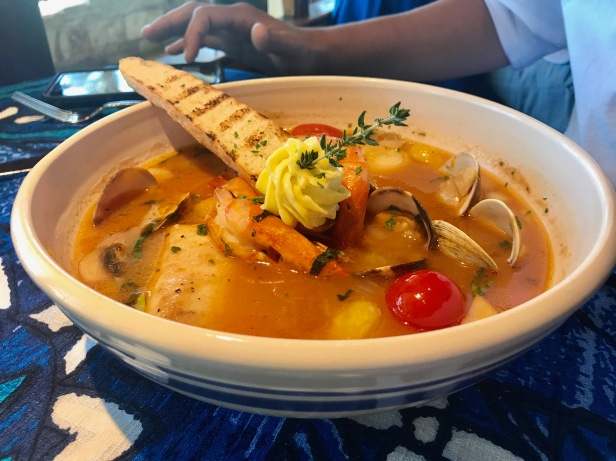 bouillabaisse - mahimahi, Kona kampachi, Kauai prawns, scallop and clams simmered in a saffron broth, with traditional garlic rouille